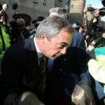 Nigel Farage gets swamped by protestors in Scotland.