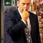 Peter Reynolds, leader of CLEAR, Cannabis Law Reform., picking his nose.