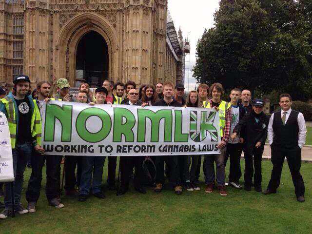 Don Barnard stands together with NORML UK outside the Houses of Parliament.