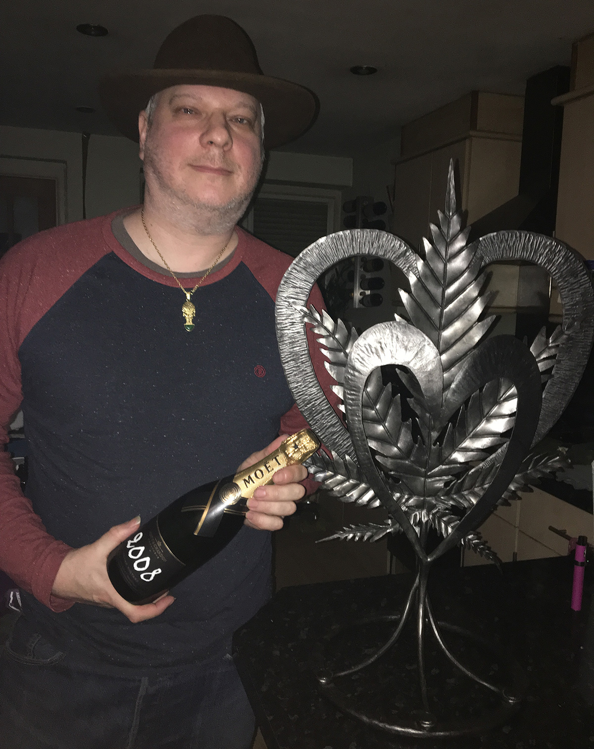 Chris Bovey with champaign and the Leaf of Peace.